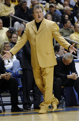 coach Huggins got a new gold suit.